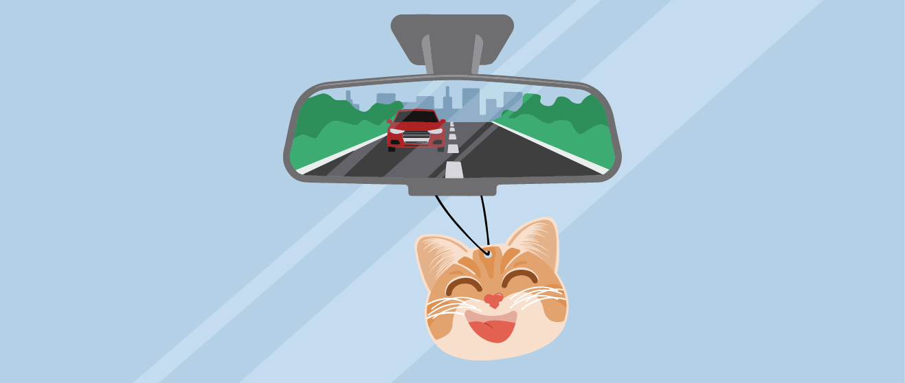 car cuties air freshener in rear view mirror